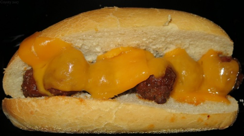 Sweet and spicy meatball grinder with cheddar