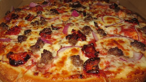 Beef, onion, and sun-dried tomato pizza