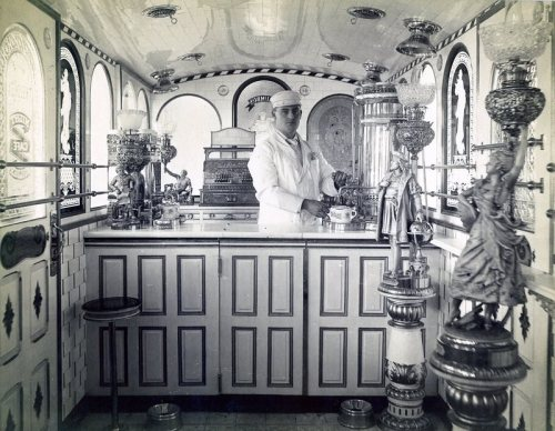 T. H. Buckley inside one of his lunch wagons.